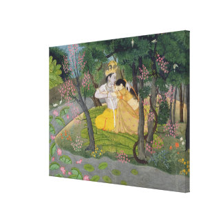 Radha and Krishna embrace in a grove of flowering Canvas Print