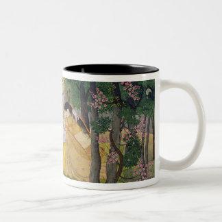 Radha and Krishna embrace in a grove of flowering Two-Tone Coffee Mug