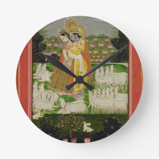 Radha and Krishna embrace in an idealised landscap Wall Clocks