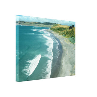 Raglan beach, New Zealand by Bruce Stanfield Canvas Print