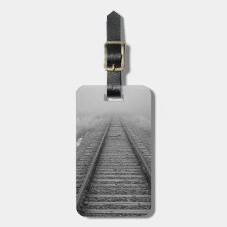 railroad tracks fade into the morning fog luggage tag