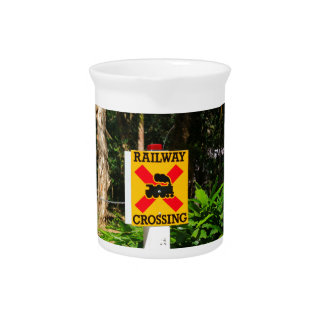 Railway crossing sign pitcher