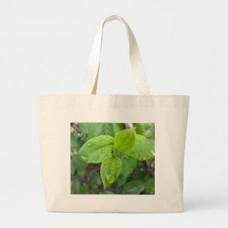Rain over leaves large tote bag