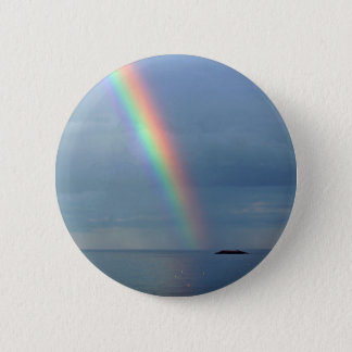Rainbow over ocean 6 cm round badge