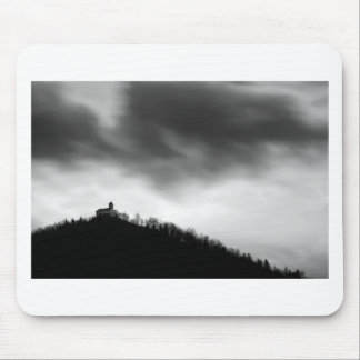 Rainclouds over church mouse pad