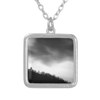 Rainclouds over church silver plated necklace