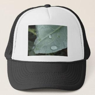 Raindrops on cauliflower leaves trucker hat