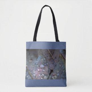 Raindrops on leaves tote bag