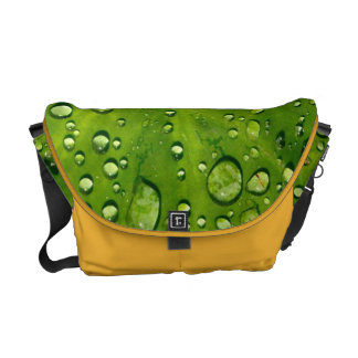 Raindrops on taro leaf messenger bag