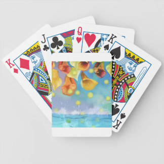 Raining tennis balls over the sea. bicycle playing cards