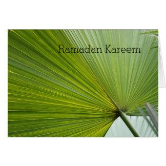 Ramadan greeting card with green palm leaf