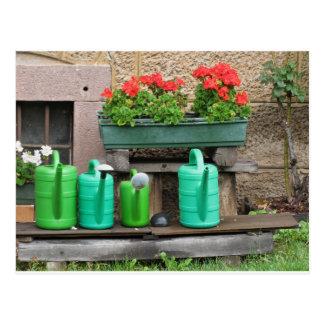 Range of plastic watering cans postcard