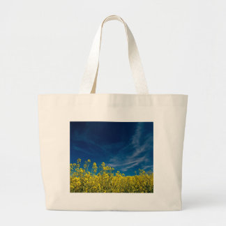 Rape field with blue sky canvas bag