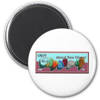 Rare_sea_glass_colors blue-fuschia stamp bkgrnd 6 cm round magnet