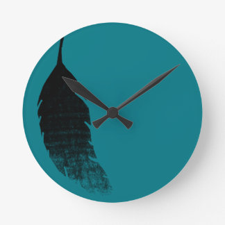 Raven's feather wall clocks