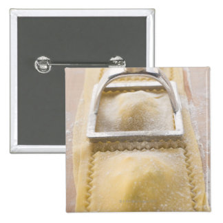 Ravioli with pastry cutter, close up 15 cm square badge