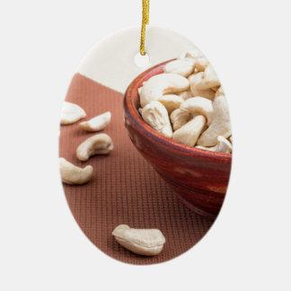 Raw cashew nuts for vegetarian food closeup ceramic oval decoration