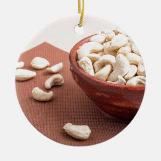 Raw cashew nuts for vegetarian food closeup round ceramic decoration