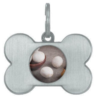 Raw champignon mushrooms and onions pet name tag