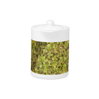 Raw chopped pistachios in a plastic food pan