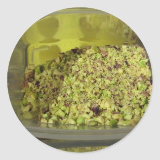 Raw chopped pistachios in a plastic food pan classic round sticker
