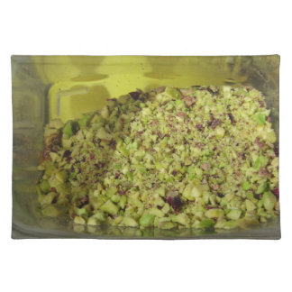 Raw chopped pistachios in a plastic food pan placemat
