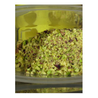 Raw chopped pistachios in a plastic food pan postcard