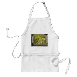 Raw chopped pistachios in a plastic food pan standard apron