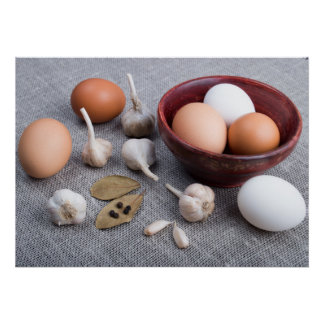 Raw eggs and garlic and spices on the kitchen poster