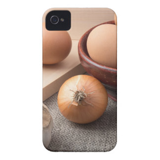 Raw eggs, onions and garlic on a background Case-Mate iPhone 4 cases