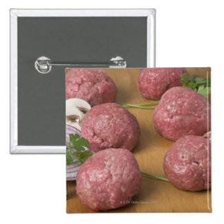 Raw meatballs on a cutting board 15 cm square badge