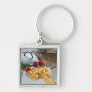 Raw pasta on weight scale Silver-Colored square key ring