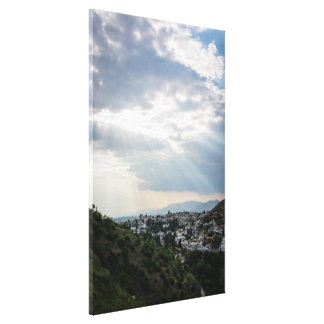 Rays of sunlight filtered through storm clouds canvas print