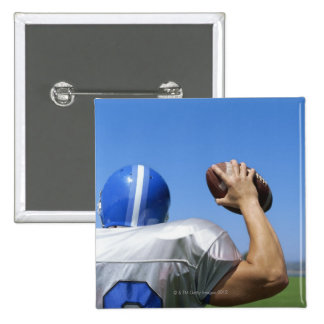 rear view of a football player throwing a 15 cm square badge