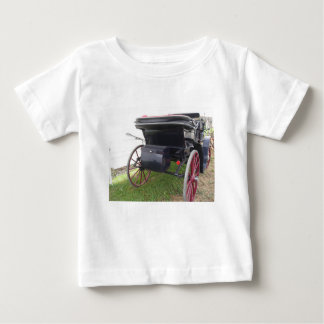 Rear view of old-fashioned horse carriage on green baby T-Shirt
