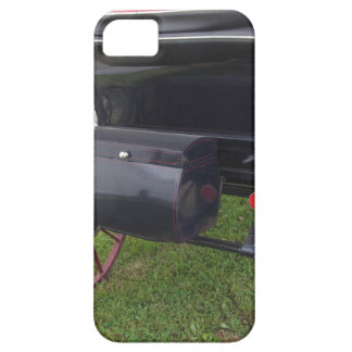 Rear view of old-fashioned horse carriage on green case for the iPhone 5
