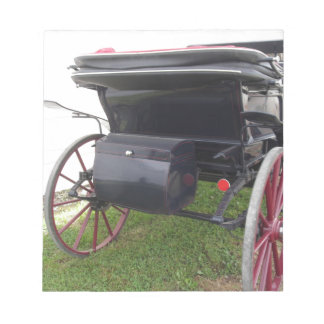 Rear view of old-fashioned horse carriage on green notepad