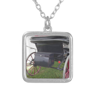 Rear view of old-fashioned horse carriage on green silver plated necklace