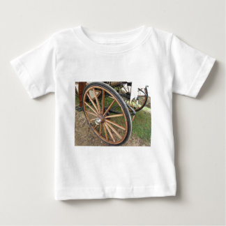 Rear wheels of old-fashioned horse carriage baby T-Shirt