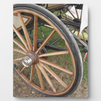 Rear wheels of old-fashioned horse carriage plaque