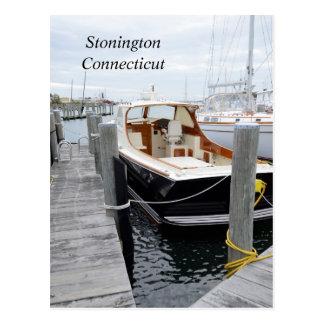 recreation boat docked in a marina postcard