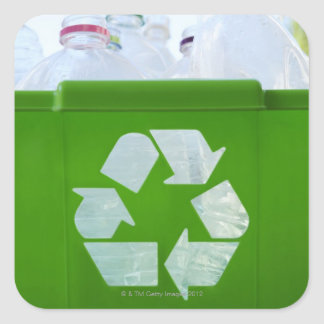 Recycling logo cut out of green plastic sticker