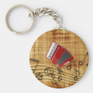 Red accordion, black notes, gold background key ring