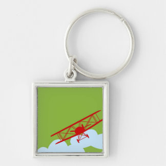 Red airplane on plain lime green. keychain