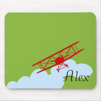 Red airplane on plain lime green mouse pad
