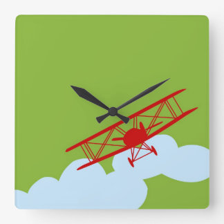 Red airplane on plain lime green. wall clock
