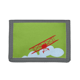 Red airplane on plain lime green. tri-fold wallets