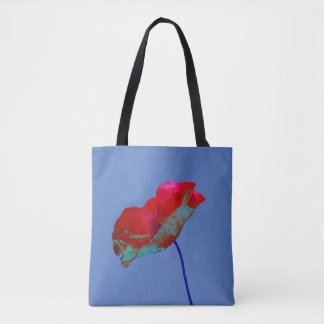 Red and blue poppy flower art print on blue tote bag