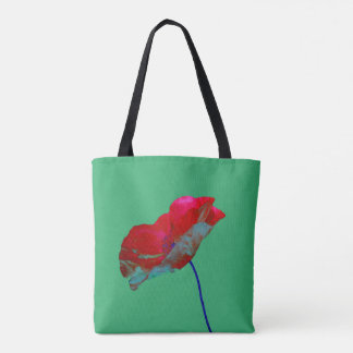 Red and blue poppy flower art print on green tote bag