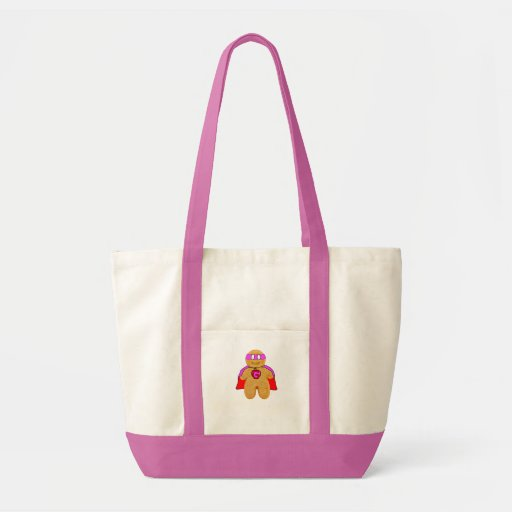 red and pink gingerbread man super hero character tote bag